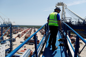 Crane department supervisor Chad Swan walks on the upper catwalk of a ship-to-shore crane at Wando Welch Terminal operated by the South Carolina Ports Authority in Mount Pleasant