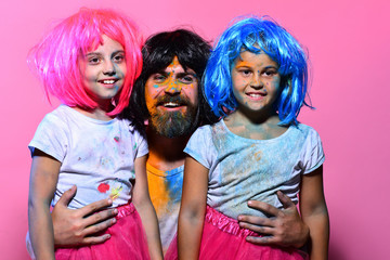 Positive emotions and holiday concept. Schoolgirls and man with beard