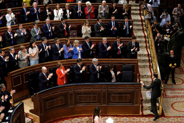 Spain's Prime Minister Mariano Rajoy is applauded after giving a speech at a motion of no confidence debate at Parliament in Madrid