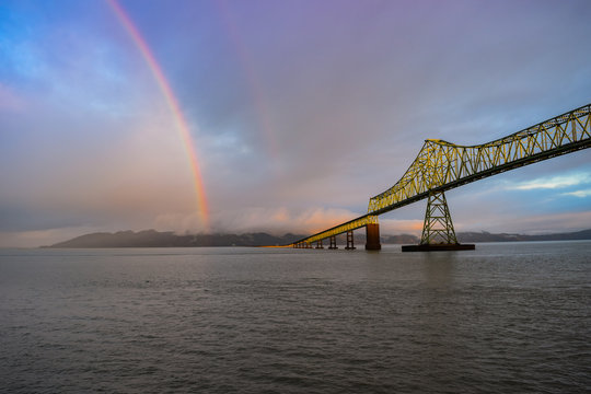 Rainbow over river and bridge in Astoria, Oregon