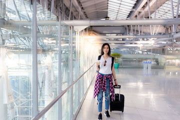 Charming beautiful woman has just arrived to her country at the airport. Attractive asian university student girl feels happy when pretty young girl comes back to her country. She hold a cup of coffee