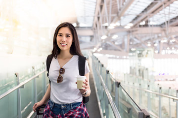 Charming beautiful university student. Attractive girl just comes back from foreign or oversea country. Pretty woman feels happy when gorgeous girl arrive to her country or airport, hold cup of coffee