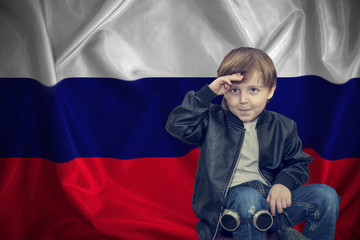 Independence Day in Russia, June 12, Russian patriotic background. Russian A boy salutes his hand,