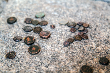 Old coins found on archaeological excavations in India in the province of Hampi
