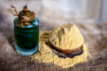 Close up of  powder of ayurvedic herbs Triphala a mixture especially used in hair care to have long and silky smooth hairs with its extract beneficial oil.