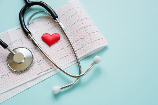 Cardiogram and stethoscope on blue
