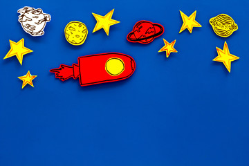 Autocollant pour porte Cosmos Space tourism concept. Drawn rocket or spaceship near stars, planets, asteroids on blue background top view copy space