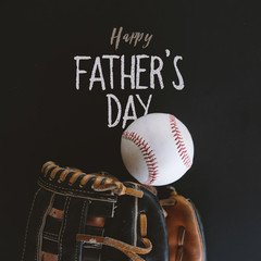 Happy fathers day baseball holiday graphic with handwritten style text on blackboard.