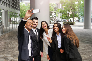Business people of different ethnic backgrounds dressed in suits and suits, they take a picture in which they smile and they are all happy. Concept of: internationality and technology, social networks