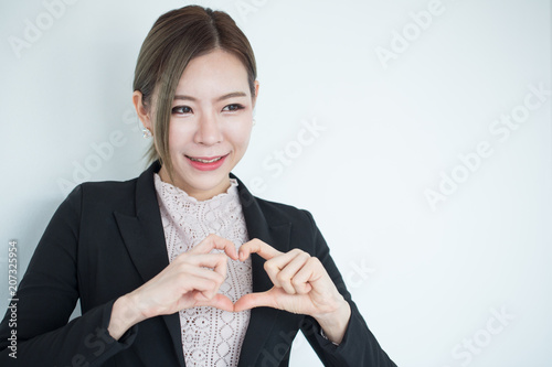 b464e4e4d6 Young asian business woman smiling on background with copy space ...