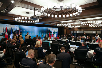 Delegates listen to a welcome ceremony during the G7 Development Ministers meeting at the G7 Summit in Whistler