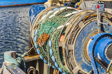 fishing boat in the harbor - detail shot from fishing net