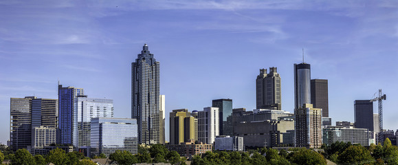 Wall Mural - Downtown Atlanta Skyline showing several prominent buildings and hotels under a blue sky.