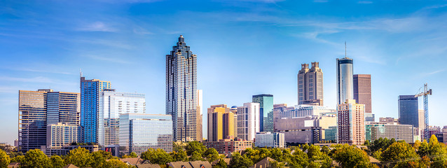 Downtown Atlanta Skyline showing several prominent buildings and hotels under a blue sky. Wall mural