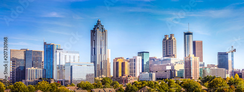 Wall mural Downtown Atlanta Skyline showing several prominent buildings and hotels under a blue sky.