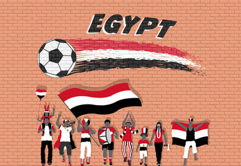 Egyptian football fans cheering with Egypt flag colors in front of soccer ball graffiti
