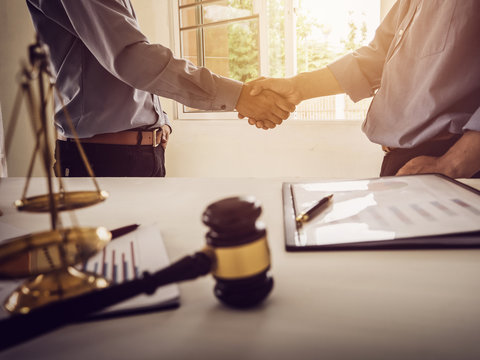Shaking hands partnership tax lawyer and real estate agent.