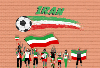 Iranian football fans cheering with Iran flag colors in front of soccer ball graffiti