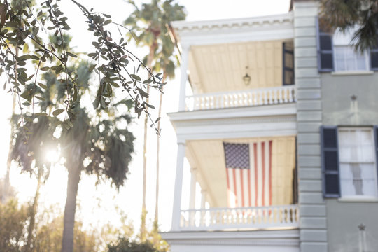 American flag hanging from southern porch in Charleston, South Carolina