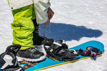 female snowboarder wears snowboard equipment