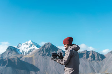 Man taking photo of beautiful view of mountains