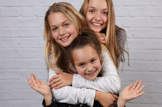 Portrait of three sister girls having fun and laughing. Happy kids, carefree childhood concept