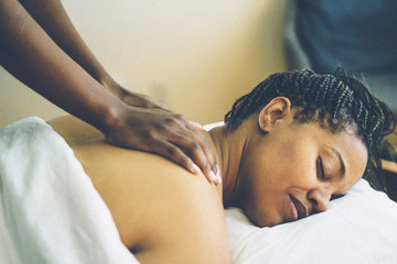 Woman receiving back massage at spa
