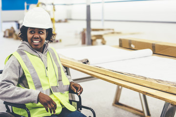 Smiling female project manager sitting in wheelchair