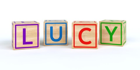 The name lucy written with Isolated wooden toy cubes
