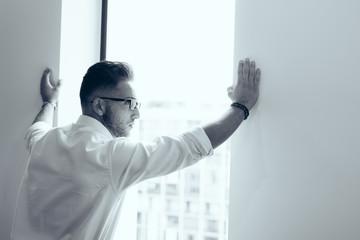 Millennial businessman thinking