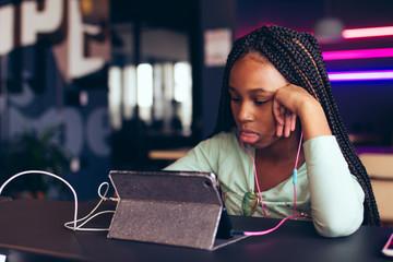 Teen girl looking at digital tablet