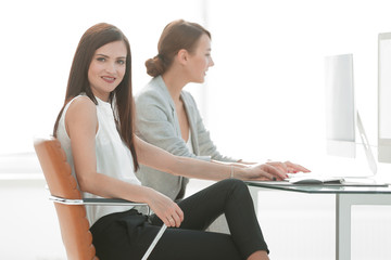 two employees sitting at the Desk