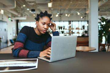 Millennial woman working on laptop