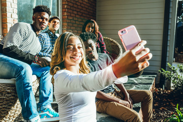 Group of friends taking selfie on a smart phone