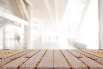 Perspective empty wooden table on top over blur background, can be used mock up for montage products display or design layout.