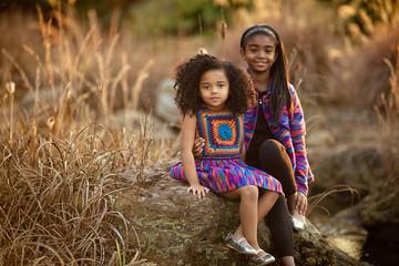 Two girls posing outdoors