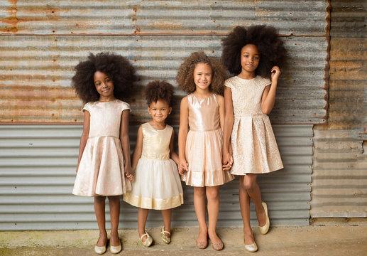 Smiling girls standing against shutter