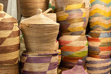 Large hand-made colored baskets in an African market