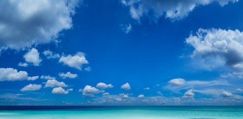 Beautiful sea and a blue sky with white clouds .
