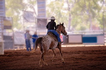 Young Rider In Hard Hat Competes In A Rodeo Event