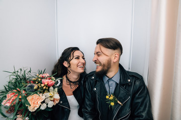 Wedding in the style of rock. Rocker or Biker wedding. Guys with stylish leather jackets. It's a rock'n'roll baby The sweet couple are photographed in a photobooth.