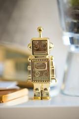 Golden robot figure on desk