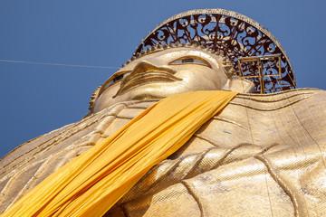 Giant standing golden Buddha at Beautiful Wat Intharawihan temple in Bangkok, Thailand