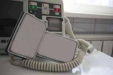defibrillator on the hospital bed in the ward