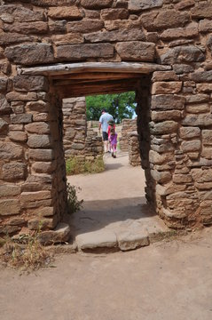 Tourists Walking through the Aztec Ruins National Monument in New Mexico