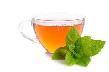 Glass cup of Tea with mint leaves isolated on white background