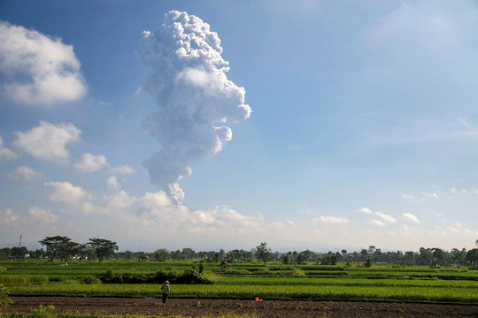 Mount Merapi volcano is seen during an eruption from Prambanan, Klaten, Central Java