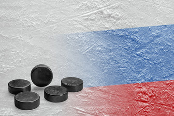 Image of the Russian flag on ice and hockey pucks