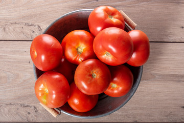 top view of tomatoes on a wooden table
