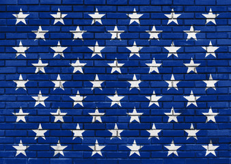 Fifty White Stars on the painted blue brick wall, American Flag theme, decorative background